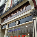tom murphy menswear logo