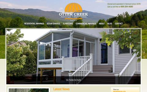 Screenshot of Home Page ottercreekawnings.com - Vermont Retractable Awnings|Sunrooms|Solar Shades - Otter Creek Awnings - captured Oct. 7, 2014