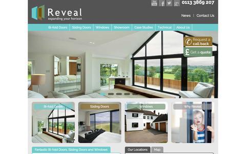 Screenshot of Home Page revealdoorsandwindows.co.uk - Timber and Aluminium Bi-fold Doors | Sliding Doors | Windows - captured Sept. 30, 2014