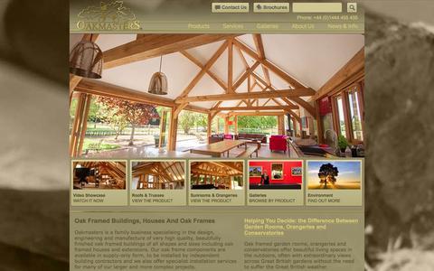 Screenshot of Home Page oakmasters.co.uk - Oak Framed Buildings, Houses & Oak Frames - Oakmasters - captured Jan. 12, 2016