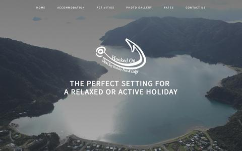 Screenshot of Home Page okiwi.co.nz - Okiwi Bay Holiday Park & Lodge - captured June 15, 2016