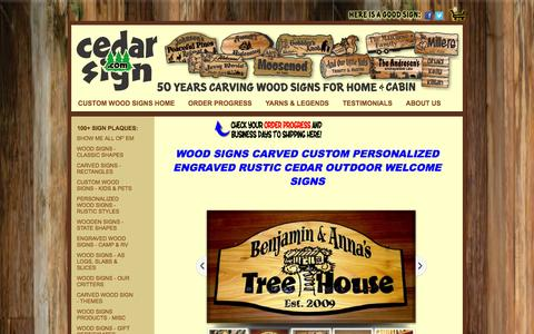 Screenshot of Home Page cedarsign.com - CUSTOM CARVED WOOD SIGNS Personalized Engraved Name - captured Oct. 2, 2014