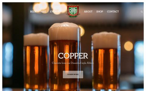 Screenshot of Home Page oldemeckbrew.com - The Olde Mecklenburg Brewery – Charlotte Born and Brewed! - captured May 22, 2018