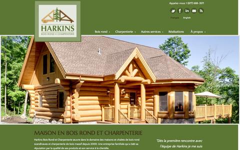 Screenshot of Home Page harkins.ca - Maison en bois rond et charpenterie | Harkins.ca - captured Oct. 2, 2014