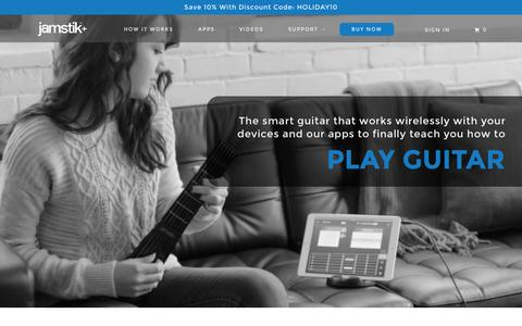 Screenshot of Home Page jamstik.com - Learn How-To Play Guitar with Apps | Jamstik+ The SmartGuitar by Zivix - captured Nov. 24, 2015