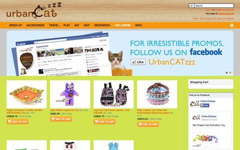 Screenshot of Home Page urbancatzzz.com - UrbanCATzzz – Urban cat products for modern cat living | fancy cat costume, cat clothes, cat collars, cat leads, cat harnesses, cat leashes, cat toys, catnip, cat scratchers, cat bowls, cat feeders, cat beds, cat domes, cat carriers, cat bags, cat po - captured Sept. 23, 2014