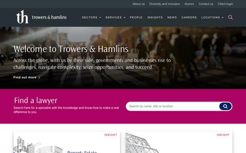 Screenshot of Home Page trowers.com - Welcome to Trowers & Hamlins - across the globe, with us by their side, governments and business rise to challenges, navigate complexity, seize opportunities and succeed. -Trowers & Hamlins International Law Firm - captured July 12, 2019