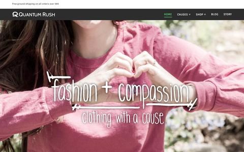 Screenshot of Home Page quantumrush.com - Quantum Rush | fashion + compassion, clothing with a cause - captured July 24, 2015