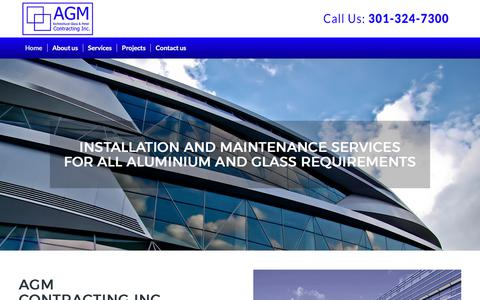 Screenshot of Home Page agmcontracting.com - Architectural Glass & Metal Contracting, Inc. - captured Oct. 6, 2017
