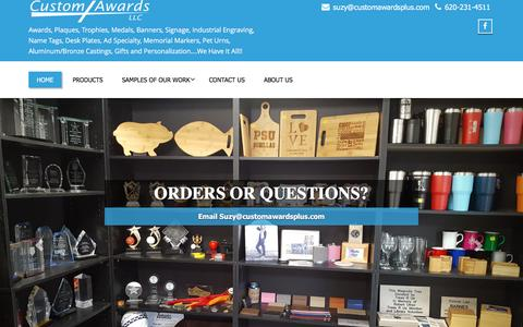 Screenshot of Home Page customawardsplus.com - Custom Awards, LLC – Awards, Plaques, Trophies, Medals, Banners, Signage, Industrial Engraving, Name Tags, Desk Plates, Ad Specialty, Memorial Markers, Pet Urns, Aluminum/Bronze Castings, Gifts and Personalization….We Have It All!! - captured April 10, 2017
