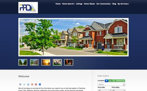 Screenshot of Home Page Signup Page prismpd.com - Indian Trail | Charlotte | Waxhaw NC Area Real Estate | Property Management By Prism Properties & Development Inc - captured Oct. 3, 2014