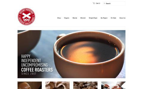 Screenshot of Home Page organiccoffee.com - Organic Coffee Cartel - Happy, Independent, Uncompromising Coffee Roasters since 2007 - captured Oct. 7, 2014